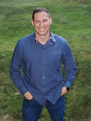 "Michael S. Amaral, author of the children's book ""Ella Plant Plants a Tree."""