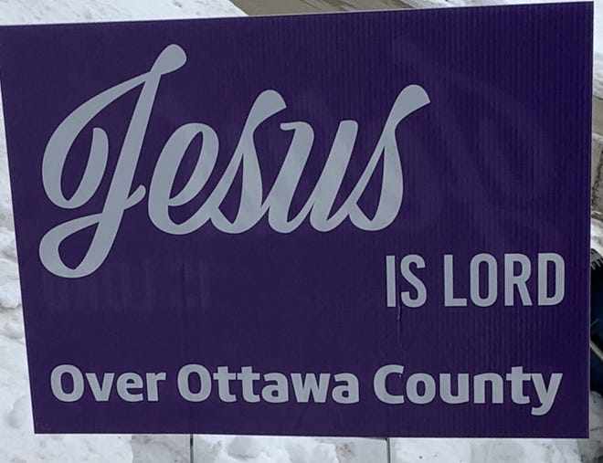 A yard sign in Ottawa County promotes Christianity.