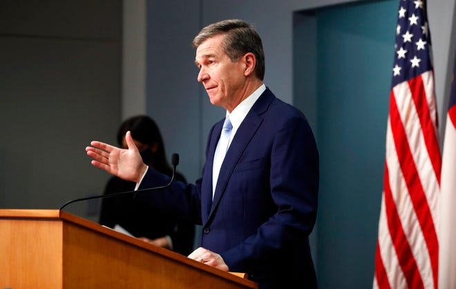 Gov. Roy Cooper speaks during a briefing at the Emergency Operations Center in Raleigh Feb. 10. North Carolina's governor would have to get formal support from other elected leaders to carry out long-term emergency orders in a measure approved Wednesday by the state House.(Ethan Hyman/The News & Observer via AP)