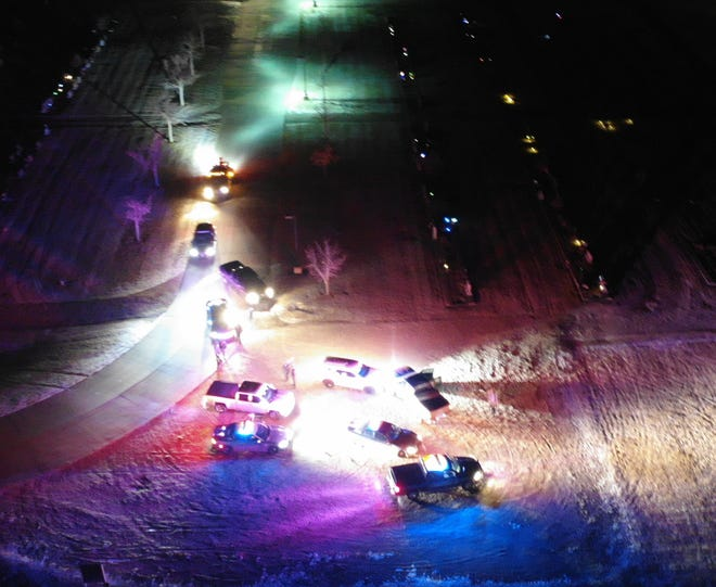 This aerial photo taken from a drone shows Barton and Pawnee County sheriff's deputies surrounding a vehicle that led authorities on a 4-mile pursuit that began in Great Bend.