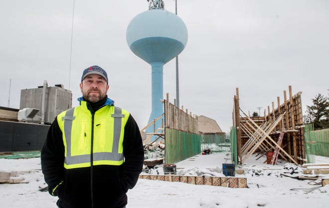Water treatment supervisor Trent Reid stands near the beginnings of a new facility for treating ammonia in raw water, part of a $10.8 million, 1 1/2-year improvement project at the Morton Water Treatment Plant on Detroit Avenue.