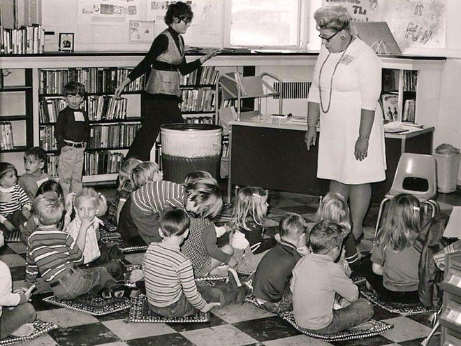 Children sit down for an activity in the Children's Library in the basement of the Carenegie Library building, 203 N. Main. The Children's Library was part of a 1937 expansion to a building opened in 1904.