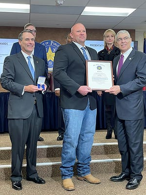 Texas Department of Public Safety Director Steven McCraw present a Purple Heart award to Sgt. Jerrod Burtnett, DPS-Lubbock, for his actions during a multi-vehicle accident near Lubbock on Dec. 27, 2019, in which he sustained injuries.