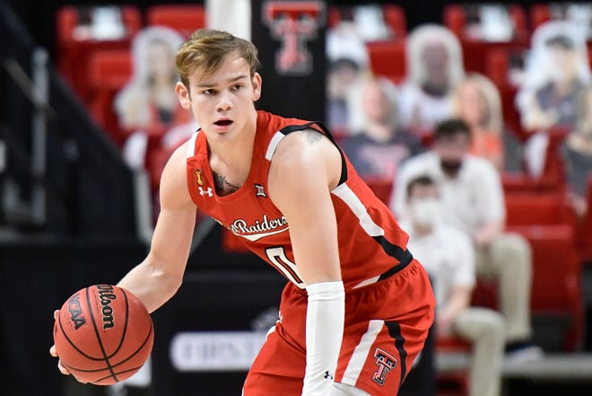 Texas Tech's Mac McClung (0) controls the ball during the first half of a Big 12 Conference game Tuesday against No. 14 West Virginia at United Supermarkets Arena. The No. 7 Red Raiders lost 82-71. [AP Photo/Justin Rex]