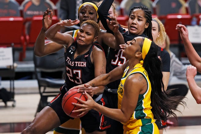 Texas Tech's Khadija Faye (23) tries to steal the ball from Baylor's DiJonai Carrington during the first half of a Big 12 Conference game Wednesday at United Supermarkets Arena. [AP Photo/Brad Tollefson]