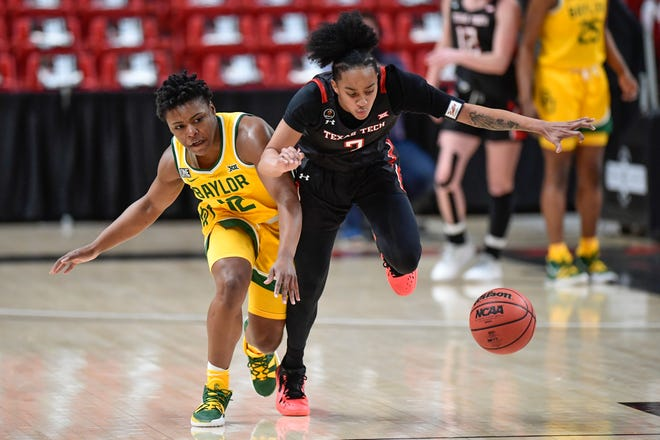 Texas Tech's Maka Jackson (3) and Baylor's Moon Ursin (12) chase down a loose ball during the first half of a Big 12 Conference game Wednesday at United Supermarkets Arena. [Justin Rex/for A-J Media]