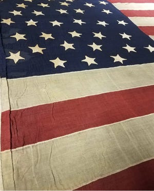 The Middletown Flag was hand sewn by women from Middletown, adorned the Atlanta, Illinois Wide Awakes parade float during the August 8, 1860 Wide Awakes rally for presidential candidate Abraham Lincoln in Springfield.
