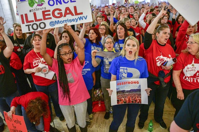 In this March 5, 2018 file photo, teachers hold a rally outside the Senate Chambers in the West Virginia Capitol in Charleston, W.Va. A West Virginia state senator introduced a bill on Wednesday, Feb. 10, 2021, that would allow striking teachers to be fired. The bill also would allow county boards of education to order the pay of an employee to be forfeited for each day of their participation in a strike.