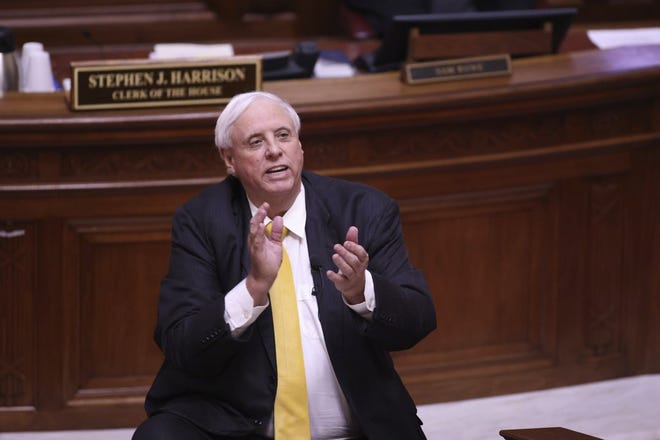 West Virginia Governor Jim Justice applauds the West Virginia Supreme Court Justices during the State of the State Address in the House Chambers of the West Virginia State Capitol Building in Charleston, W.Va., on Wednesday, Feb. 10, 2021.