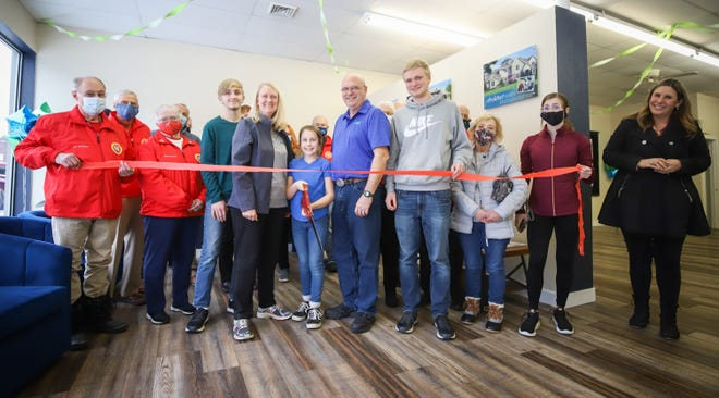 Wausau Homes of Moberly owners Kathryn and Gary Rae, along with their family, stand in the middle among Moberly Area Chamber of Commerce Ambassadors and guests that attended a Feb. 8 ribbon cutting and open house ceremony. The new custom home building business is located at 515 W. Reed St. in downtown Moberly.