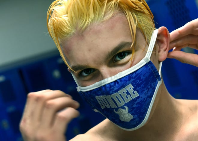 Ashton Rakebrand smiles after he washed the bleach out of his hair at Rootz Hair Salon in Dundee.