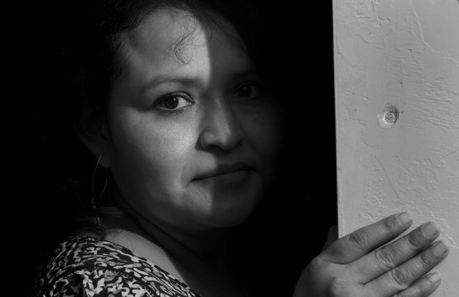 Blanca Keiser, who is a survivor of domestic violence, poses in her home in Oklahoma City on a Friday night. The Oklahoman and Telemundo collaborated on a project investigating domestic violence in the Hispanic community and the unique barriers survivors face.