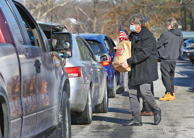 The Mass. Military Support Foundation had a drive-through food pantry at Pageant Field Quincy for area veterans on Thursday, Feb. 11, 2021.