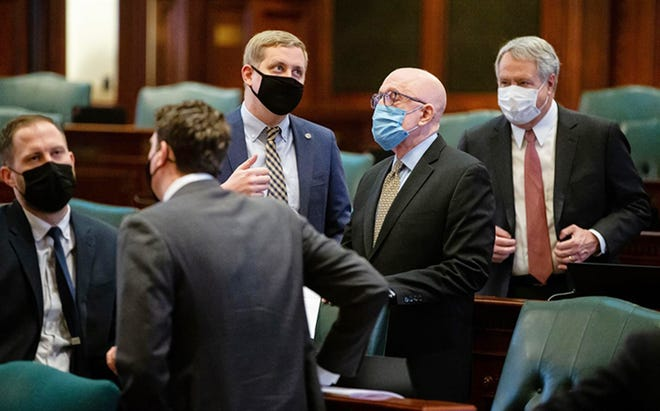 Rep. Tom Demmer, R-Dixon, and Majority Leader Greg Harris, D-Chicago, converse on the floor of the Illinois House Wednesday before discussing proposed House rules for the 102nd General Assembly
