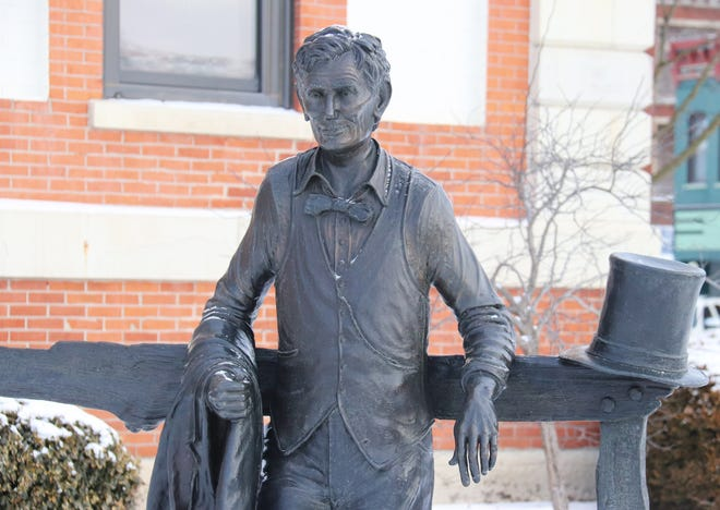 Abraham Lincoln doesn't appear to be doing anything special today, just hanging out at the Historic Courthouse in downtown Pontiac. Government offices are closed in honor of the 16th president's natal anniversary.