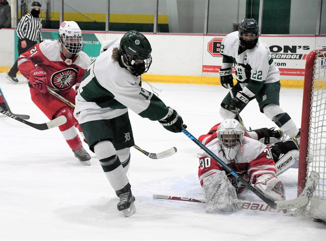 Dover's Jackson Carroll, left, is stopped by Spaulding goalie Nick Gagnon during Division II action Wednesday in Dover.