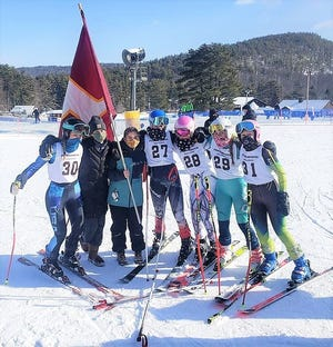 Members of the Portsmouth High School girls alpine ski team celebrate after placing second at Wednesday's Division I state championship meet at Gunstock Mountain Resort in Gilford. Portsmouth scored 706 points, while Bedford won with 711 points.
