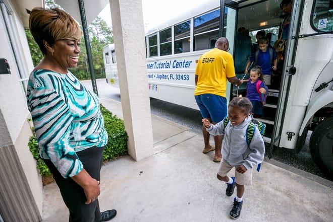 In this 2018 photo, Edna Runner greets children arriving to her namesake tutorial center in Jupiter.