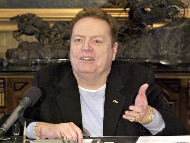 """FILE - Larry Flynt Publications Inc. (LFP) Publisher Larry Flynt comments on the resignation of former New York Governor Eliot Spitzer, during an interview with The Associated Press in his office in Beverly Hills, Calif. on March 14, 2008. Flynt, who turned """"Hustler"""" magazine into an adult entertainment empire while championing First Amendment rights, has died at age 78. His nephew, Jimmy Flynt Jr., told The Associated Press that Flynt died Wednesday, Feb. 10, 2021, of heart failure at his Hollywood Hills home in Los Angeles. (AP Photo/Damian Dovarganes, File)"""