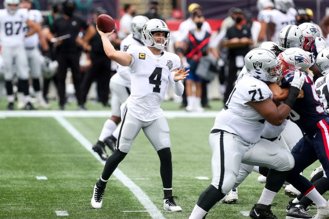 Las Vegas quarterback Derek Carr had a better day than Patriots quarterback Cam Newton during the Raiders' visit to Gillette Stadium on Sept. 27.