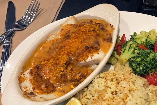 Baked Cod Newburg is topped with sauce and butter crumbs and served with Chef's Vegetables and rice. It's a special at The Casino Cafe & Grille in Tiverton during Lent.