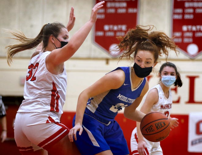 Mia DeSantis (right) and the Middletown girls basketball team travels to play regional rival Tiverton tonight.