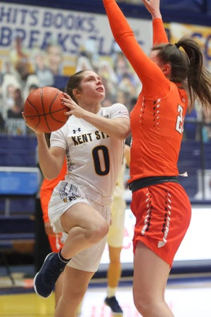 Kent State freshman guard Casey Santoro tries to work around Bowling Green freshman guard Kenzie Lewis during Wednesday night's battle at the M.A.C. Center.