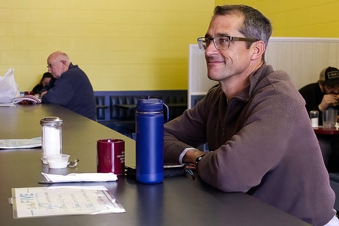 Greg Ford of Cardiff, Calif. was a among the diners at Jim's Open Kitchen, Too in Streetsboro Thursday afternoon. The restaurant has received three loans, which owner Kathleen Lawson said have enabled her to continue operations.
