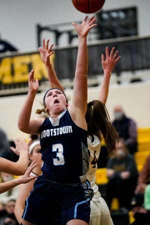 Rootstown's Abby White drives deep into the lane for a layup at Garfield Feb. 10, 2021.