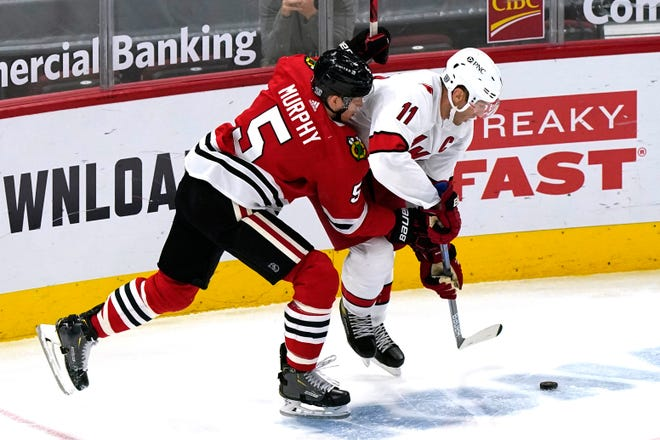 The Carolina Hurricanes' Jordan Staal, right, works for the puck against the Chicago Blackhawks' Connor Murphy during the second period Feb. 4 in Chicago.