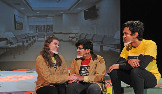 """Salina South students, from left, Mia Dennett, 17, Elias Torres, 17, and Ethen Lainer, 16, act out a scene in which an older couple ends up celebrating Christmas on Valentine's Day while in a waiting room of a clinic in the upcoming comedy """"All I need to know I learned in kindergarten!"""" The production will be available for public viewing online from Feb. 19-21. The Salina South production features 14 cast members and is being recorded by Bryan Dennett, of Salina."""