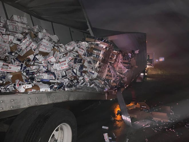 A semitrailer filled with beer sits on one side of I-95 in St. Johns County after a wreck.