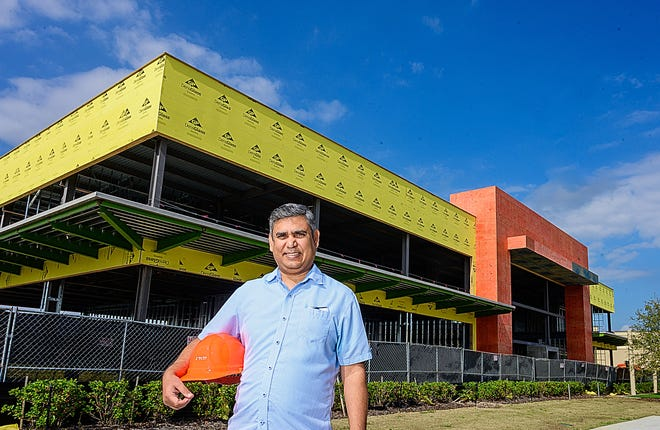 Raghu Misra stands in front of a 22,500-square-foot building he is building in the Nocatee Town Center, north of St. Augustine, to house a central hub and cowork space on Thursday, Feb. 11, 2021.