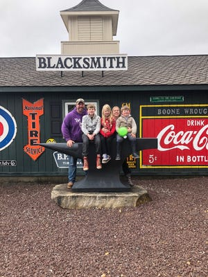 Ben Davies, left, is seen here with his family. Davies adapted his business to focus on online sales last year to survive the coronavirus pandemic.
