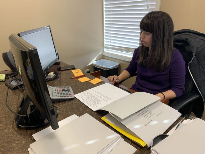 Stephanie Hudson works on tax returns for clients of ABT Tax Service.