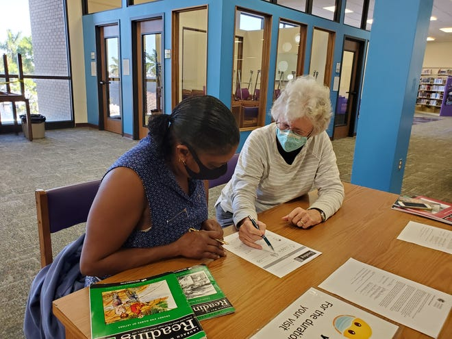 Susan MacLeod, right, a volunteer with Manatee Literacy Council since 2009, works with Tonya Furnice during a session at the Downtown Manatee Central Library.