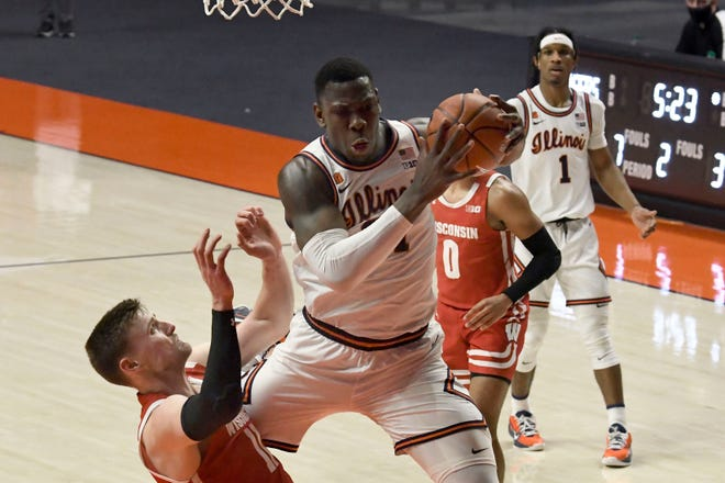 Illinois center Kofi Cockburn comes down with the ball against Wisconsin's Micah Potter in the second half Saturday in Champaign. (AP Photo/Holly Hart)
