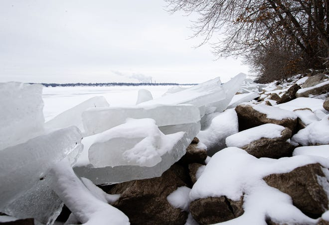 Slabs of ice are piled up on top of the rocks along the shoreline of Lake Springfield as much of the lake has frozen over. A Winter Storm Warning for Sangamon and Christian counties goes through 6 a.m. Tuesday. [Justin L. Fowler/The State Journal-Register]