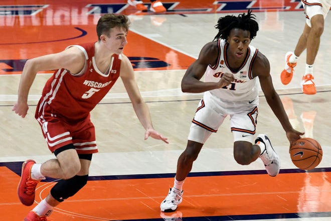 Illinois guard Ayo Dosunmu drives the ball past Wisconsin forward Tyler Wahl in the second half Saturday in Champaign. (AP Photo/Holly Hart)