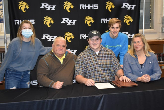 The Fusile family at Joe Fusile's signing on Wednesday, Feb. 10, 2021 at Richmond Hill High School: Sitting, from left: father Jeff, Joe and mother Teresa Fusile. Standing, from left: sister Regina Fusile and brother Wade Fusile.