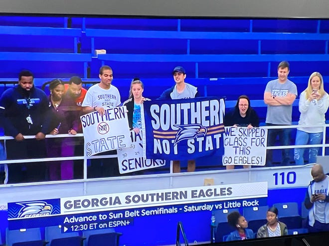 Several members of the Hanner Hooligans attended the Sun Belt tournament game at GSU Arena in Atlanta last March. Sign holders from left: JaQuaylon Taylor, Sarah Overby, Matt Durr, Ansley White.