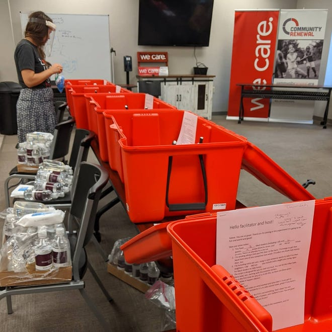 Community Renewal's Zoe Loeser prepares boxes of supplies for COVID-safe block leader meetings in summer of 2020, which took place in the yards of block leaders across the county.