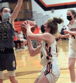 Juliette Schroeder heads in for two points against Otsego on Wednesday.