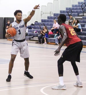 Trae Bryant (3) directs traffic for the Cape Fear Community College men's basketball team during a game in 2016. This year, Bryant is serving as the interim-head coach of the Sea Devils women's basketball team.