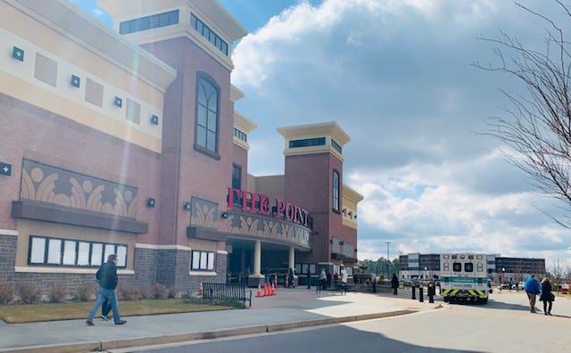 People with vaccine appointments walking up to the New Hanover Regional Medical Center Pointe 14 vaccination site.