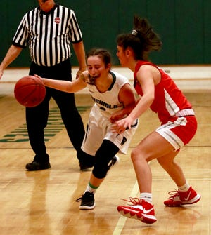 Griswold's Haley Eliasson dribbles the ball around NFA's Bella Graziano last season at Griswold High School.