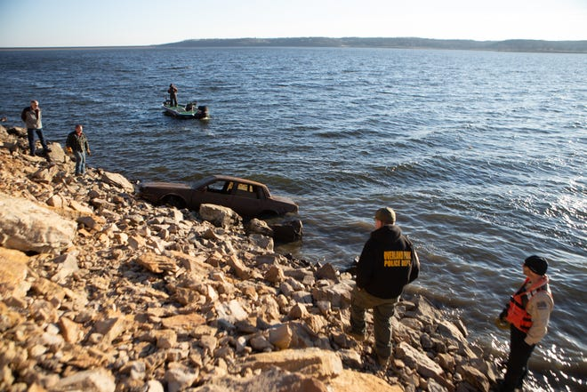 Members of the Overland Park Police Department and Kansas Wildlife Rangers watch on Feb. 3 as a car is pulled out of Perry Reservoir in Jefferson County.