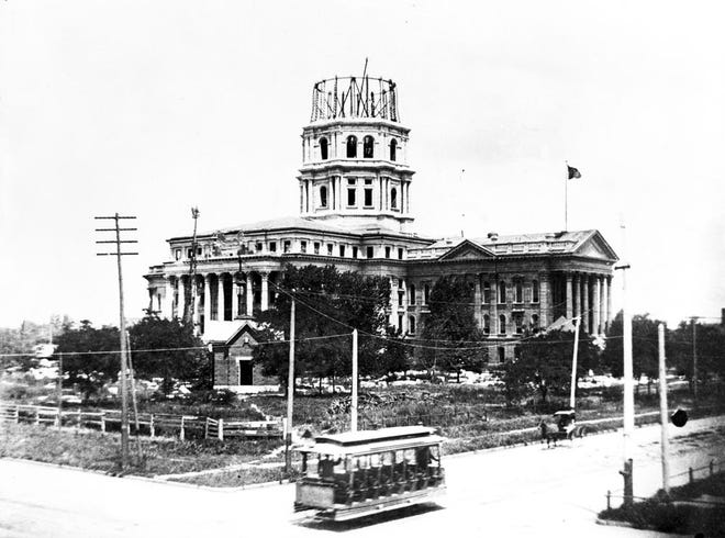"""This photo from the Kansas State Historical Society shows a trolley going past the Kansas Statehouse as construction there remained in progress. Information on trolleys will be part of a free historical Zoom presentation being offered Sunday about """"Transportation in Topeka."""""""