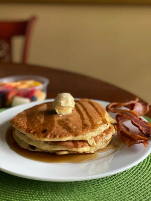 Chocolate Chip Pancakes with sides of bacon and fruit from Staks Pancake Kitchen.