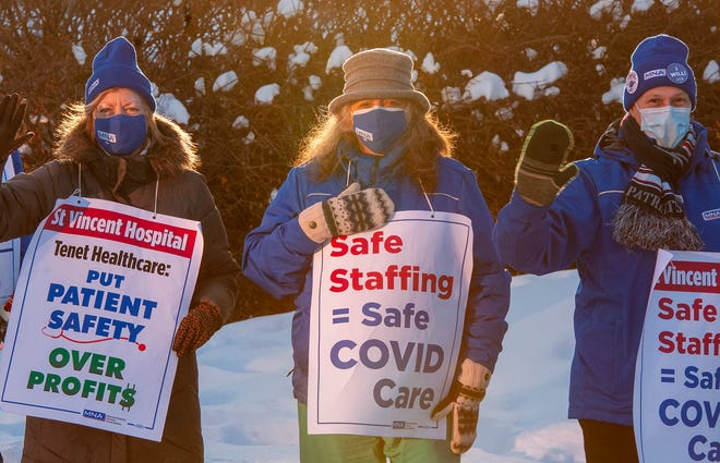 Nurses picket in front of St. Vincent Hospital on the day that their union voted to authorize a strike Wednesday.